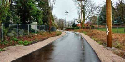 With paving of the temporary pathway complete, the Arbutus Greenway veers toward the community gardens at 6th, Photo: Naomi Reichstein